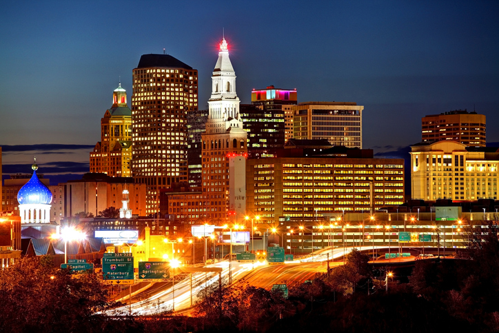 Nighttime view of Connecticut downtown area lit up with lights